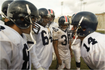 Image of a football huddle.
